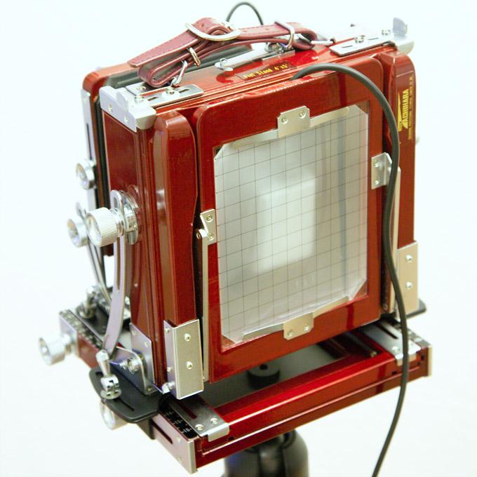 A shutter tester in place in a 4x5 camera